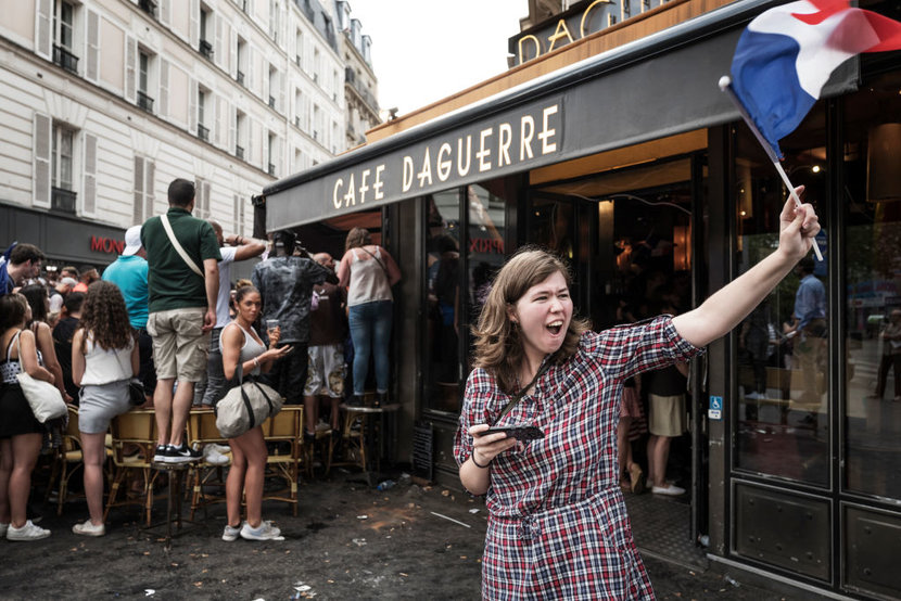 French supporters watch Frances victorious game shown in a caf against Croatia in 2018 World Cup final on Daguerre street on July 15 2018 in PARIS France