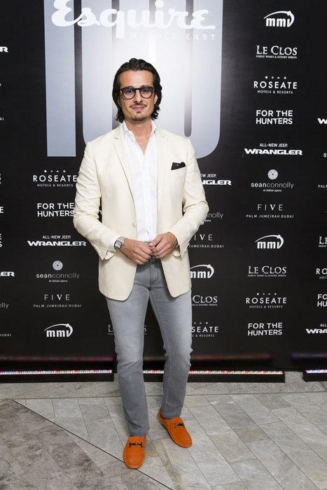 Ali F. Mostafa wearing Tod's Gomminos