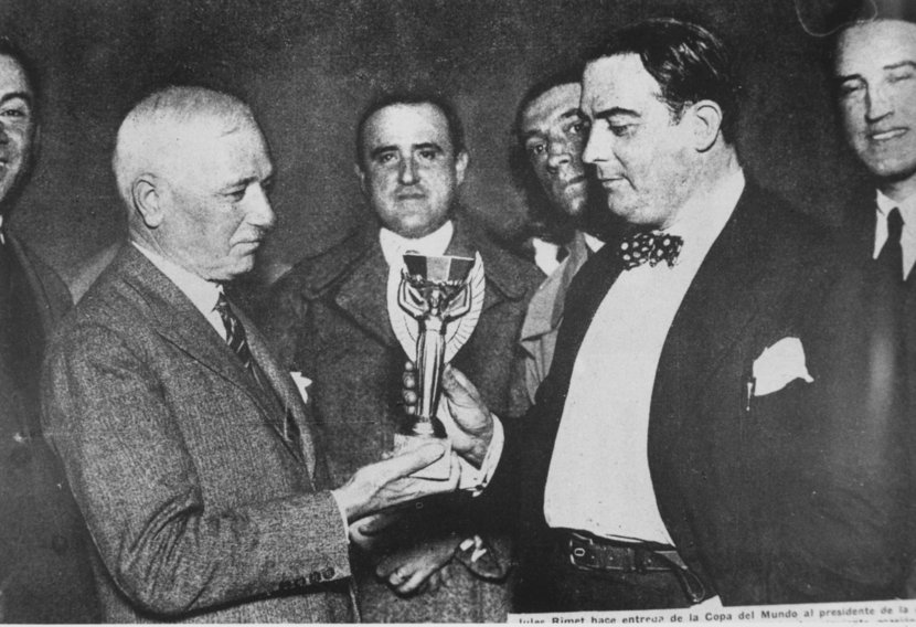 30th July 1930: Jules Rimet, president of FIFA (Federation Internationale de Football), presents the first World Cup trophy (the Jules Rimet Trophy) to Dr Paul Jude, the president of the Uruguayan Football Association, after Uruguay beat Argentina 4-2 in the first ever World Cup final in Montevideo, Uruguay.
