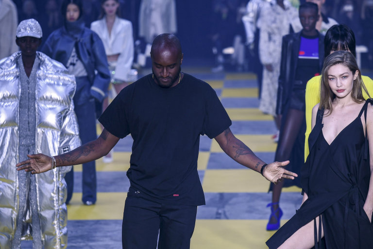 US fashion designer for OffWhite Virgil Abloh C flanked by US model Gigi Hadid R acknowledges the audience at the end of the OffWhite Womens FallWinter 20192020 ReadytoWear collection fashion show in Paris on February 28 2019 Photo by Philippe LOPEZ  AFP