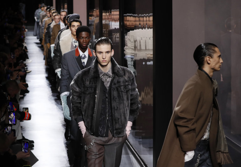 Models present creations for Dior Homme during the mens Fall/Winter 2020