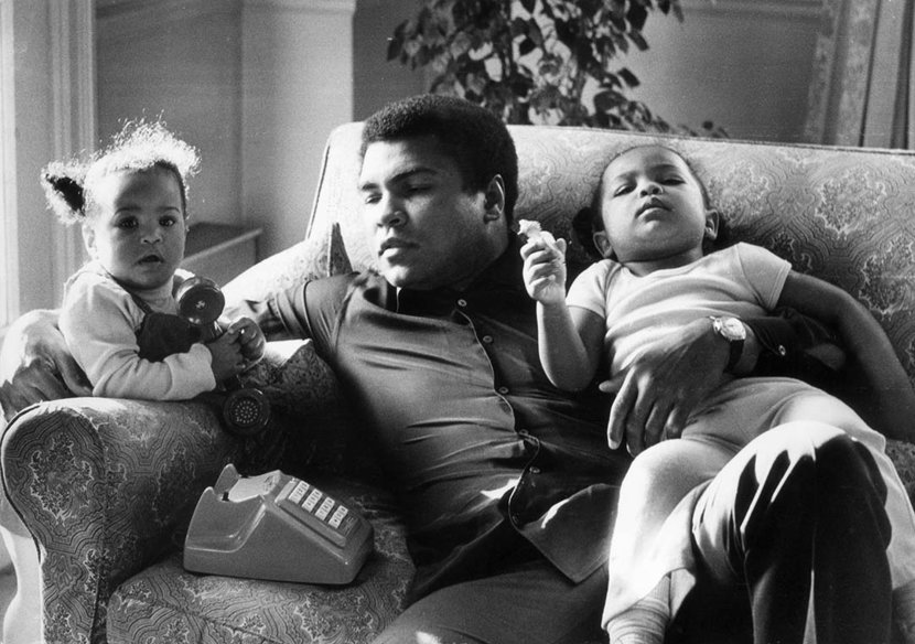 December 19, 1978  Heavyweight boxer Muhammad Ali with his daughters Laila (9 months) and Hanna (2 years 5 months) at Grosvenor House. Photo: Frank Tewkesbury