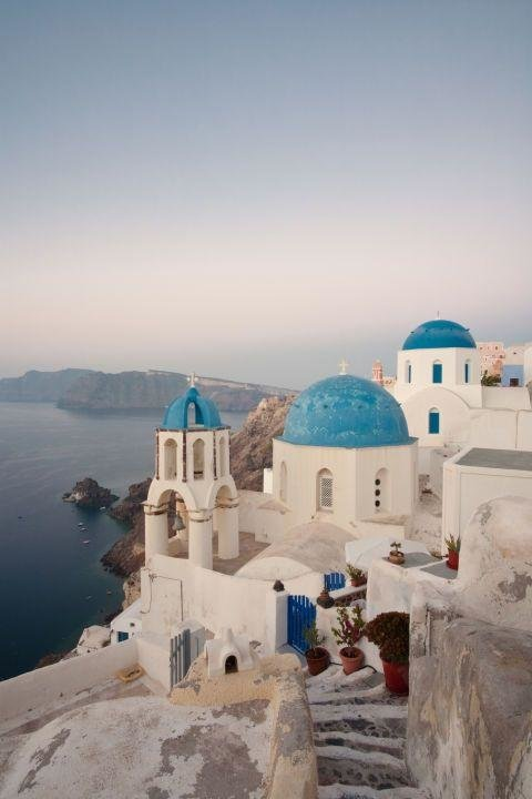 OIA, SANTORINI, GREECE - Oia, Santorini, Greece is one of the most beautiful place in the world. All of the Greek islands are undeniably beautiful, but head to the hillside town of Oia for some of the best views of the bright blue Aegean Sea.