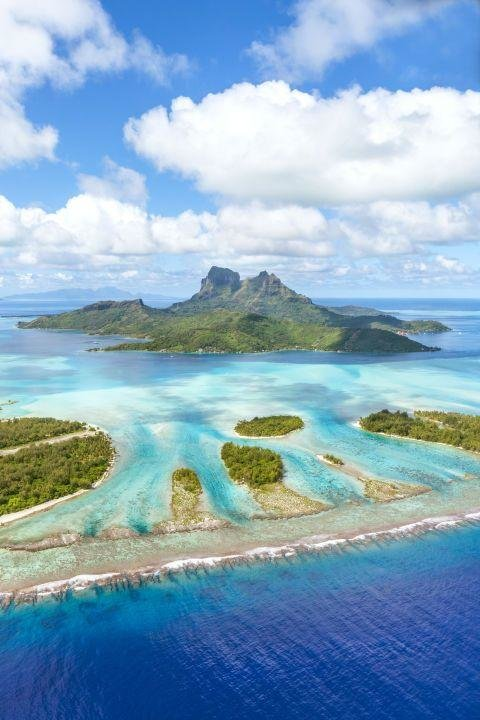BORA BORA, FRENCH POLYNESIA - With turquoise lagoons, coral reefs and overwater bungalows, this small island in the South Pacific is basically heaven on Earth.