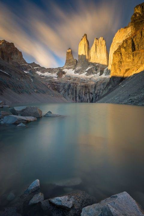 TORRES DEL PAINE NATIONAL PARK, CHILE - Most amazing places in the world to add to your travel bucket list. If you're looking to get off the grid, head to Chile's Patagonia region for some of the most beautiful mountain views you'll ever see.