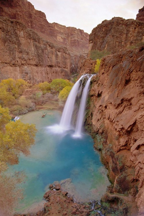 HAVASU FALLS, ARIZONA - Before you can swim in these beautiful blue-green waters located near Grand Canyon National Park, you have to hike ten miles to get there. Trust us, it's totally worth the trek.